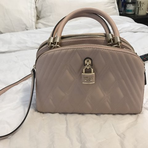 pale pink guess bag. has three compartments that makes it - Depop 418bf8095ab7d