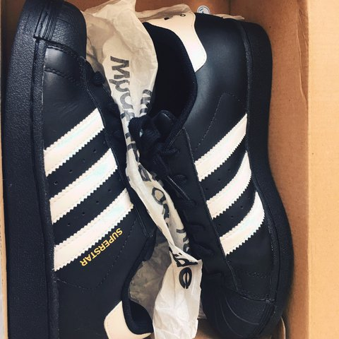 6adc0bbcd77c Adidas Superstar. Black and white with gold writing. Worn In - Depop