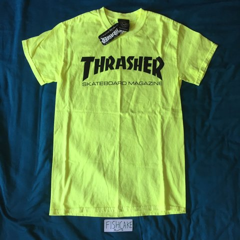 3de9580cf162 Thrasher Skateboard Magazine neon yellow tee size small. New - Depop