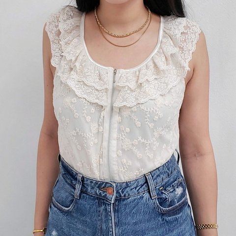 ivory lace top with ruffle neckline , zipper,