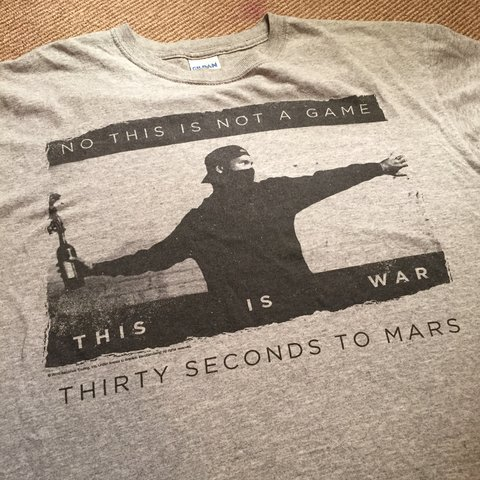 c836b922 30 Seconds To Mars t-shirt, Banksy style. Grey with faded M - Depop