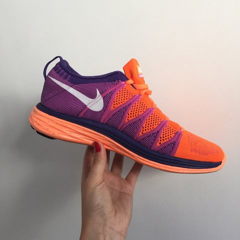 huge selection of 67354 23ea9  kikho. 4 years ago. Paris, France. Nike Women s Flyknit Lunar 2 Atomic  Orange   White   Purple.