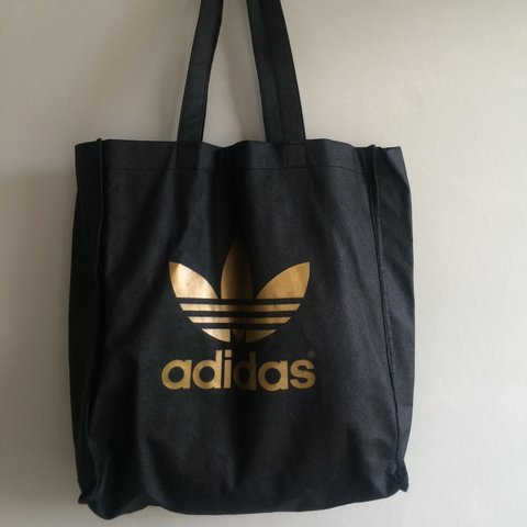 b25dc33f8c @amelialancaster. 3 years ago. Stockport, UK. ADIDAS black and gold tote bag.  Barely used and in great condition