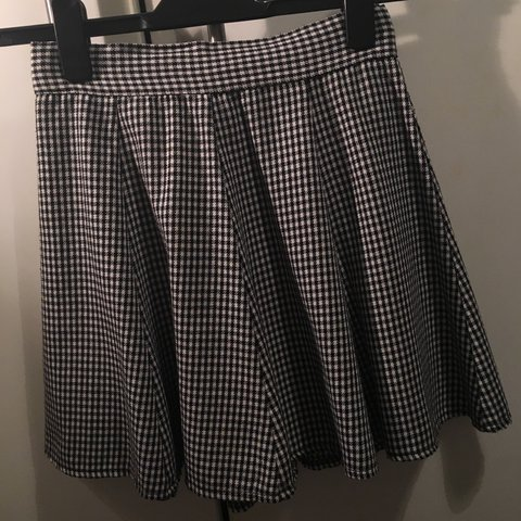 af918a63e8c3 @georginaclairebaker. 2 years ago. Woodford, United Kingdom. Brandy  Melville black & white checkered / plaid circle skater skirt. Size small ...