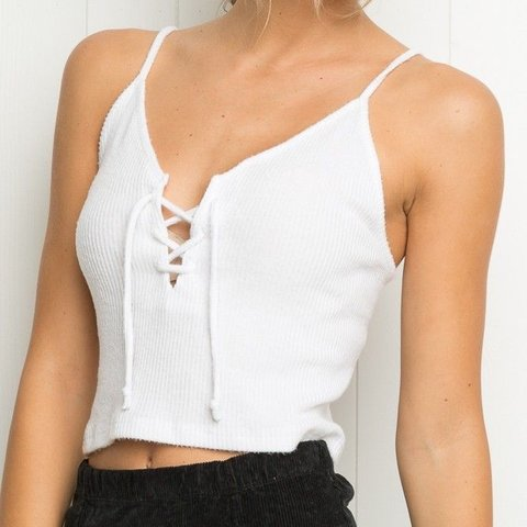 e522ef2b335 @laadyluciferr. 6 months ago. Oceanside, United States. Brandy Melville  white Bethany tank🌻 features a supaaa soft ribbed material, cropped, and lace  up ...