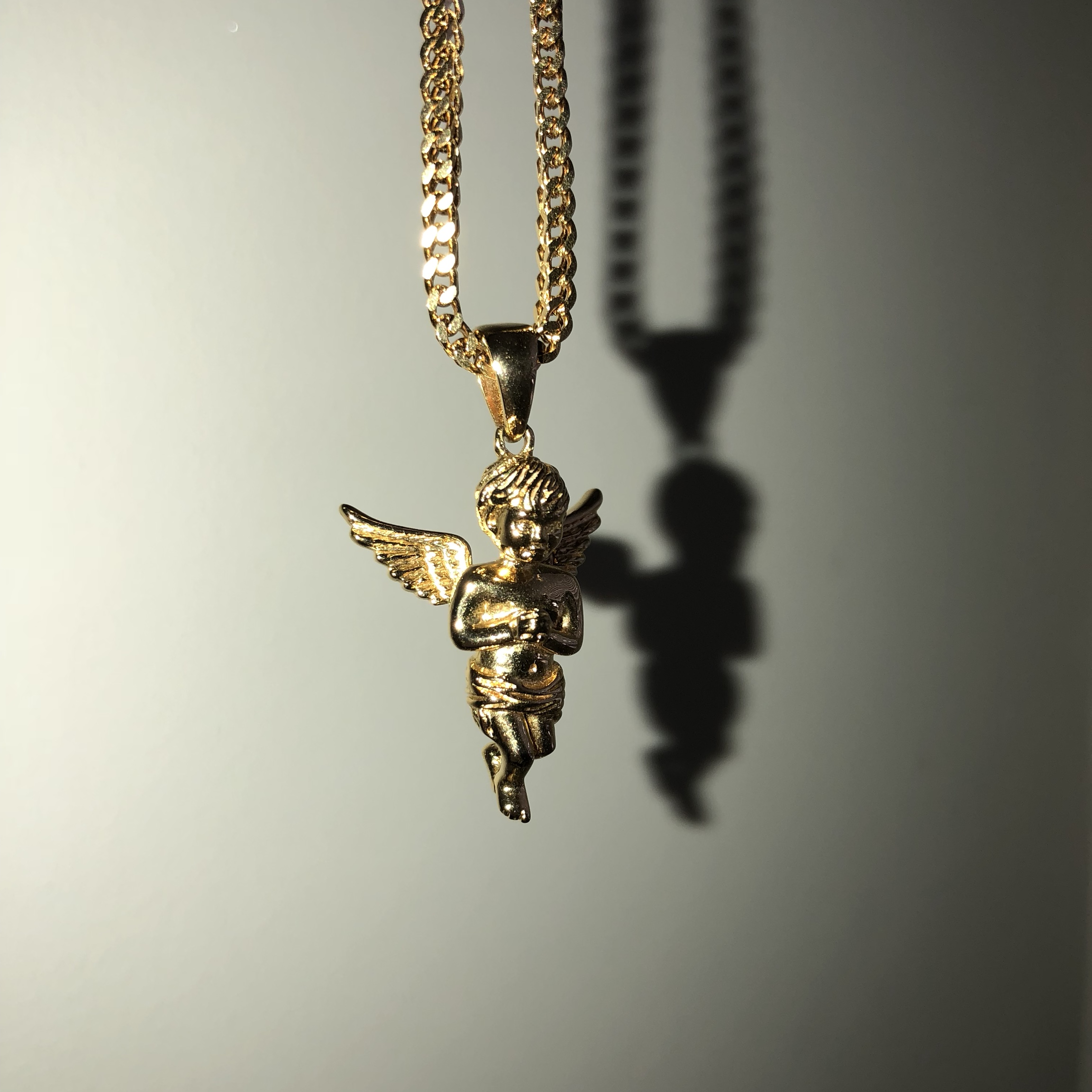 23906469440bb The Gold Gods Micro Angel Piece necklace on a 22... - Depop