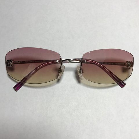 017a1402f2 Pretty vintage Chanel light pink and yellow gradient rimless - Depop