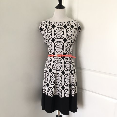 e5a6430f9573 Black and white tile print dress with a wide neckline
