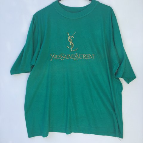 a90a2a00 @johnsvintage. 10 months ago. Portsmouth, United Kingdom. Vintage 90s YSL  Yves Saint Laurent Embroidered logo T Shirt ...