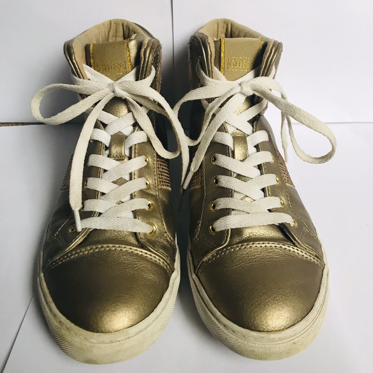 Gold, sparkly high top trainers From