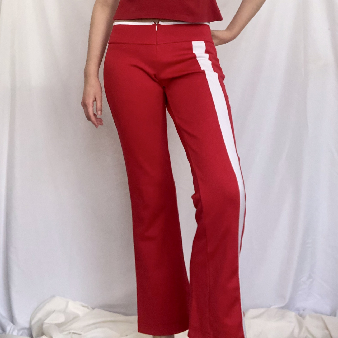 Nike red low-rise track pants with white stripe detail