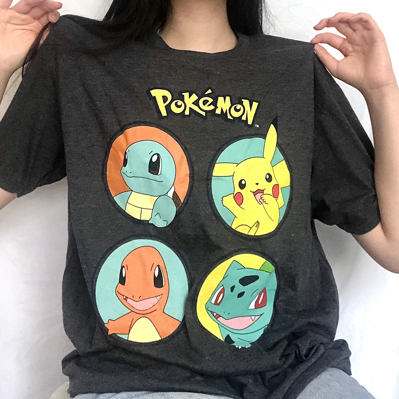 catch em' all in this Pokémon gray graphic tee