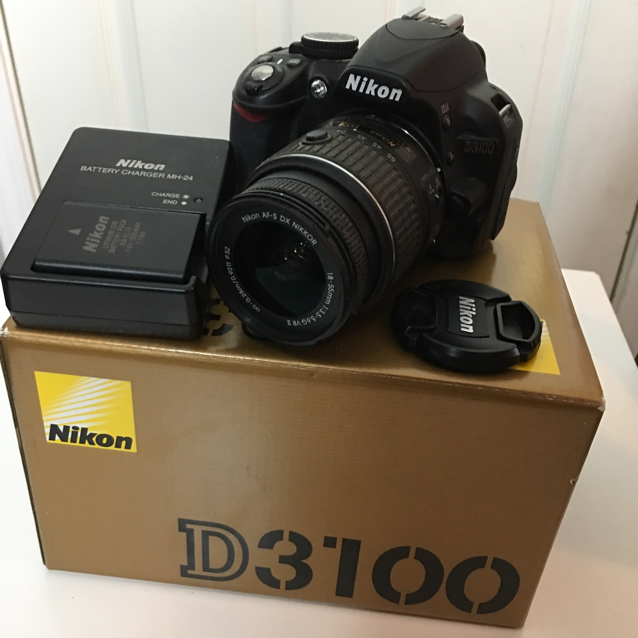 SOLD Nikon D3100 camera with box, manual, battery    - Depop