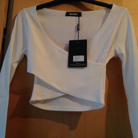 0e5cb33973f Missguided White wrap over long sleeve crop top, size 6, new - Depop