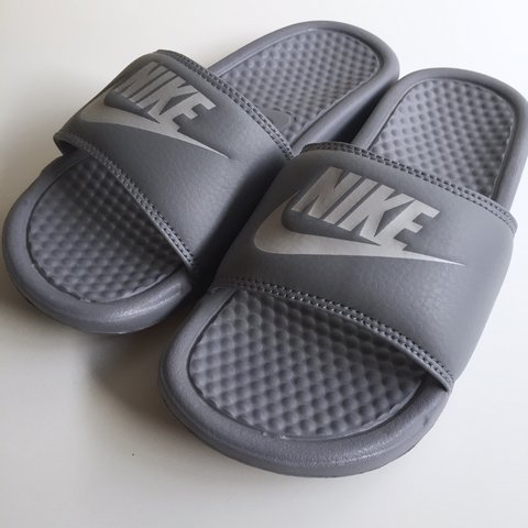 d48354a6d2b4 Rare all grey Nike Benassi slides. Comes with box if Price ✨ - Depop