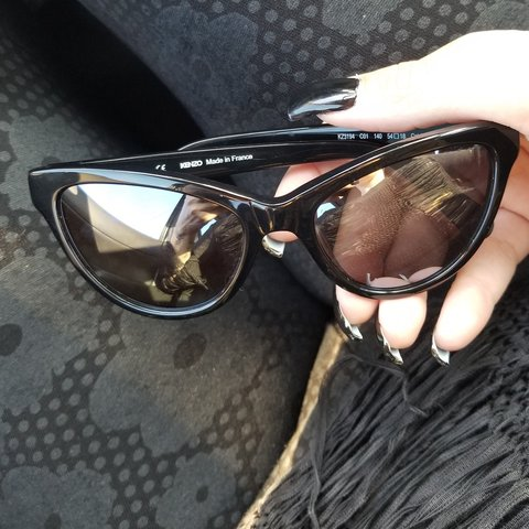 8e6283db0765 @nao_meh. 5 months ago. Baldwin Park, Los Angeles County, United States. Kenzo  cat eye sunglasses. Cute rings on the sides.