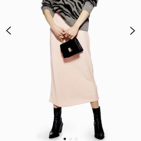 77b231985 @surreyfashion. 5 months ago. Cobham, United Kingdom. Sold out must have satin  bias cut midi skirt In pale pink from topshop.