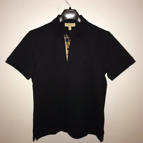 fa6f3dbe13e37 Burberry black polo with signature pattern detail. New with - Depop