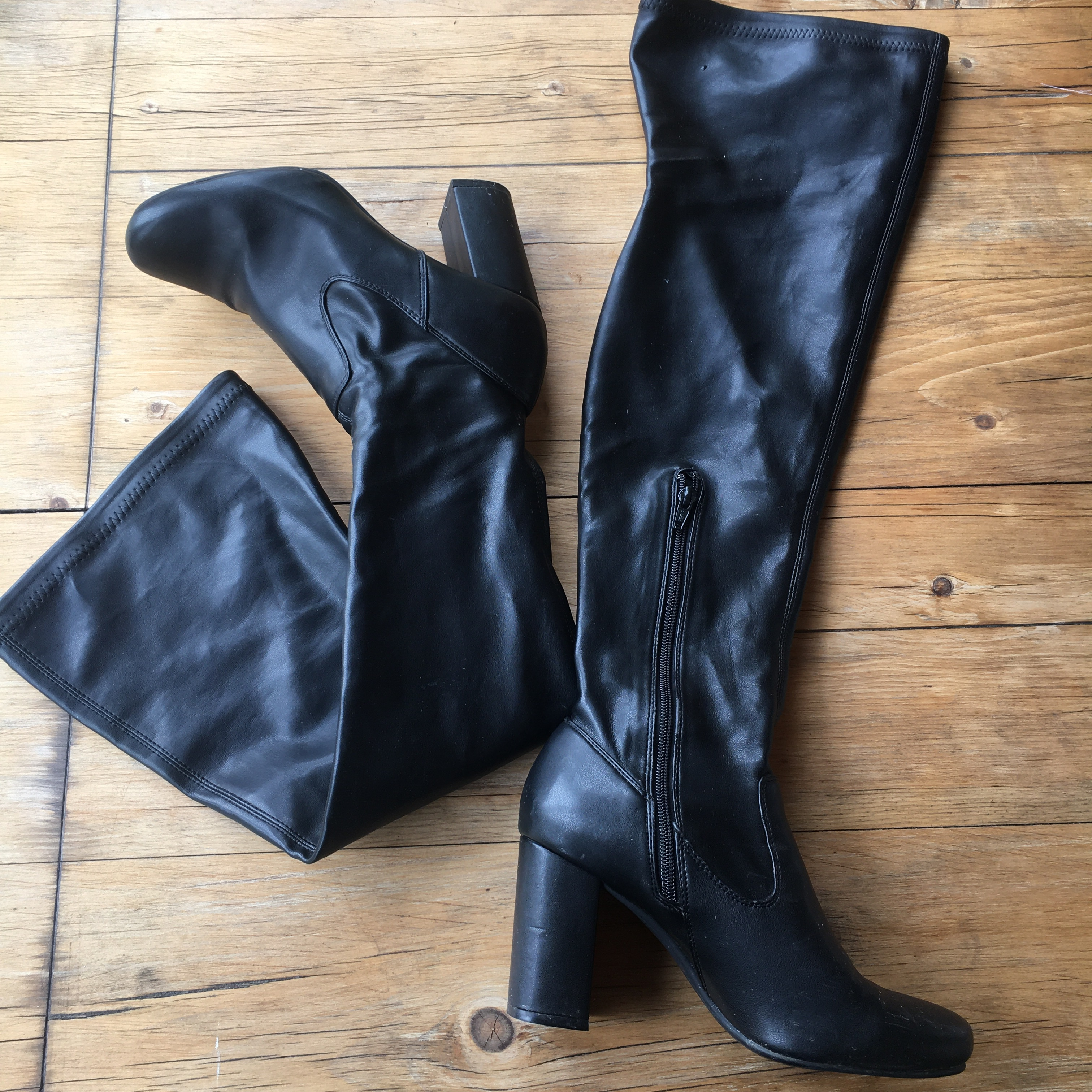 Black leather knee high boots. Size 5