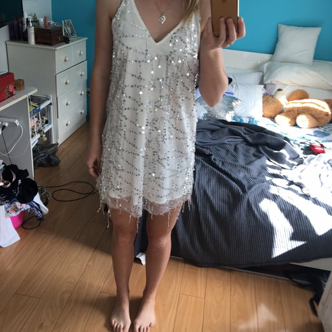 81934e91 @taylapaisnel. 2 years ago. Thornlands, Australia. White and sequin Shareen  Collections dress size 8 worn once excellent condition