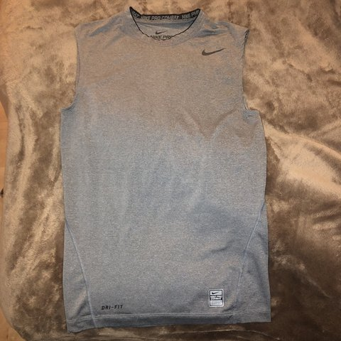 51c8ac01b8e83 Nike Pro Combat Dri-fit grey exercise top   Worn once   Size - Depop