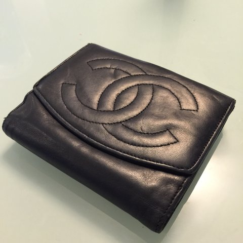 23a8c8ad899e57 @joishi. 3 years ago. Honolulu, HI, USA. Soft black leather authentic  Chanel bifold wallet.