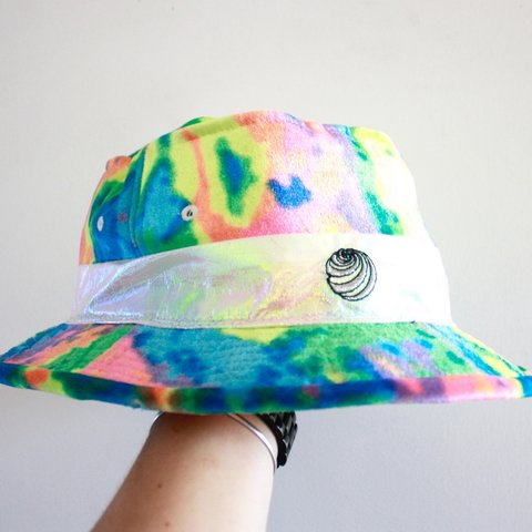 Tie dye bucket hat with iridescent band around it. and  rave - Depop 5705ae1e46c