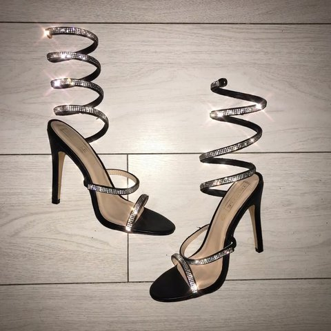 e3fc38fa56 @thevirginmary. last year. Manchester, United Kingdom. Black diamanté  Truffle Collection wrap around spiral heels