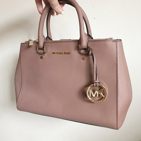 bc25f4f374ee Pre owned Michael Kors mauve leather purse. This is 100% and - Depop