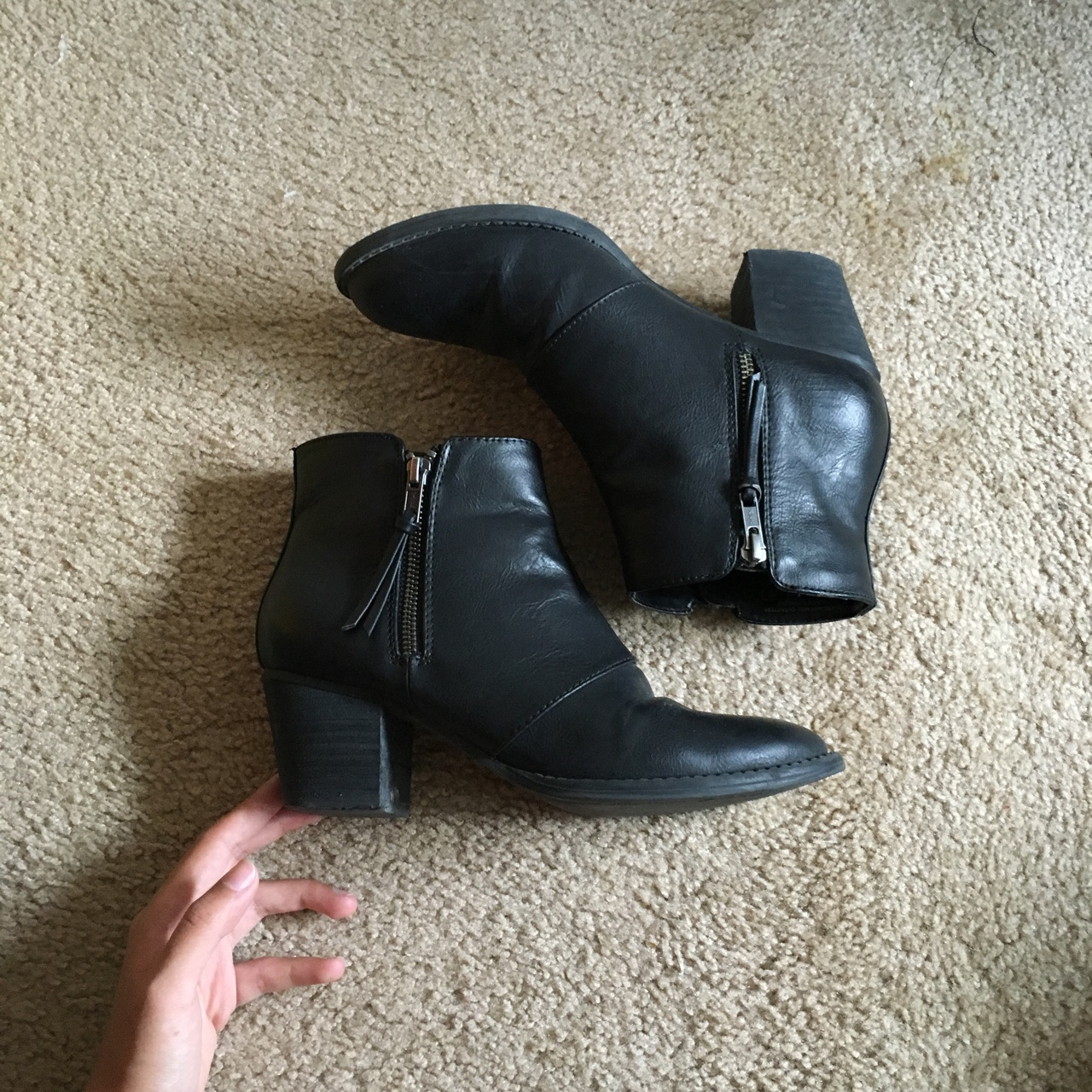 black zip up ankle boots from American