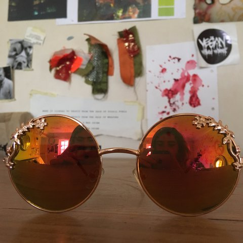6e78c02d9c88 circle shaped sunglasses with flower trim and a sunset tint - Depop