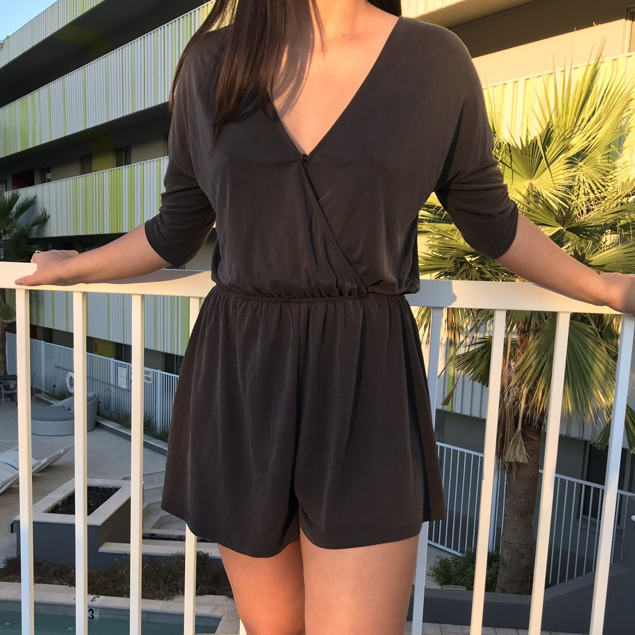 cdf2e9d7c9c9 Dark gray soft romper Has a button in front to change the - Depop