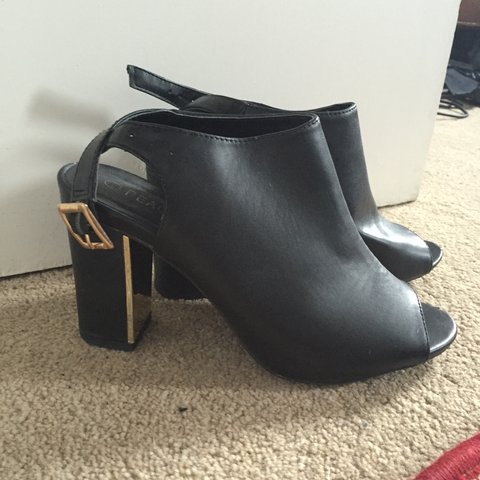 5c1777dc097 Peacock gold flash heel boots. Perfect if you want a heel. - Depop