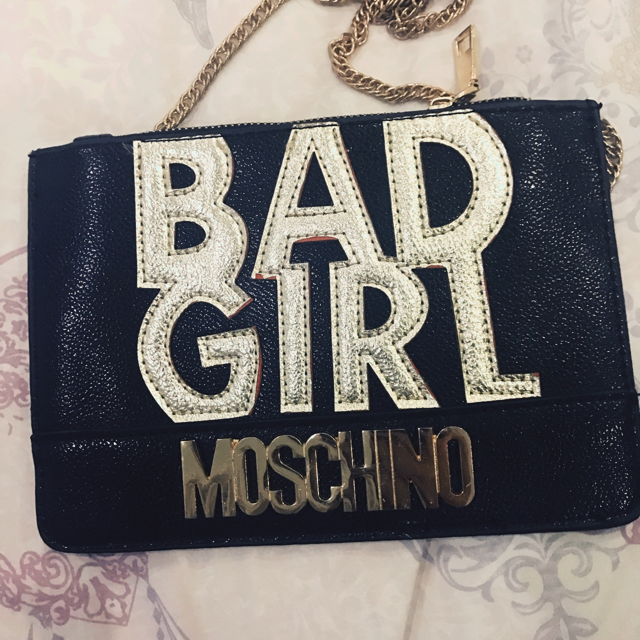 Moschino clutch bag or side bag. Black and gold. Depop