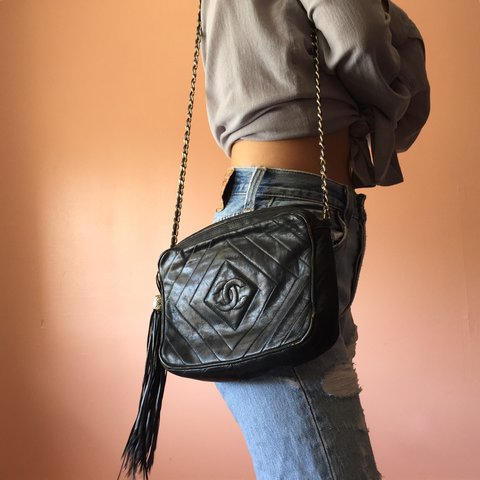 7a037e71e413 @the_spirited. 2 years ago. Los Angeles, United States. Party in this vintage  Chanel chevron camera crossbody bag.
