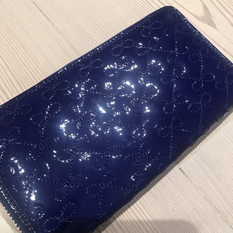 88195e6f011 Anya Hindmarch deep blue lacquered leather wallet with bow - Depop