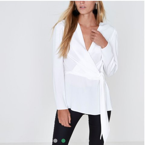 7d71447b2375f8 @zarabangura_27. last year. Bournemouth, United Kingdom. White river island  wrap front tie waist blouse.
