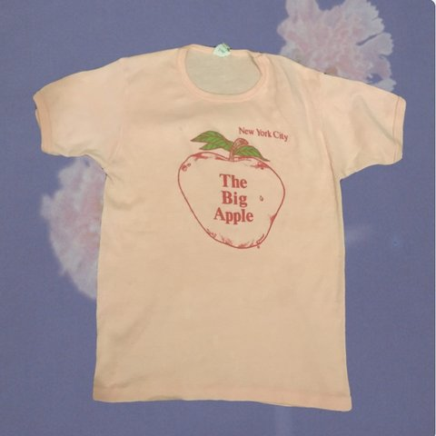 316e0194a @dewypetals. last month. New York, United States. Vintage 70s 80s peach NYC  tee.