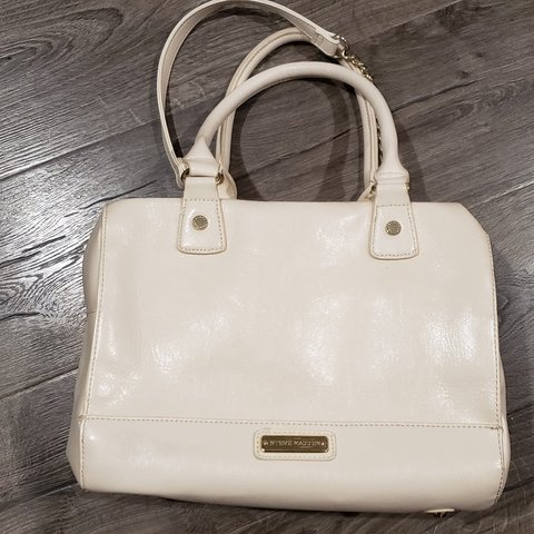 2480f5f261 @lovevasmakeup. 6 months ago. San Francisco, San Francisco County, United  States. Steve Madden cream purse. With chain strap