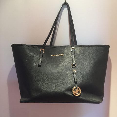 Genuine Micheal Kors plain black tote bag with gold writing. - Depop 4aef33d2a428