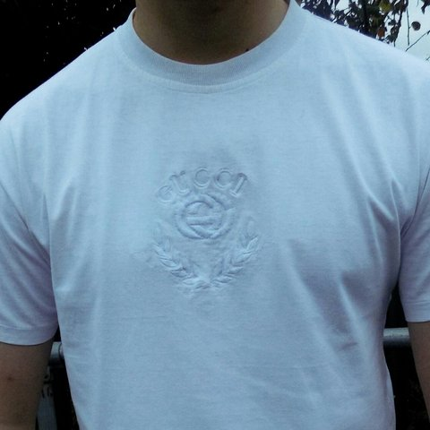 fcf49c05 @robsrack. 2 years ago. Worcestershire, UK. Vintage early 90s Gucci heavy  embroidery T-shirt in white.