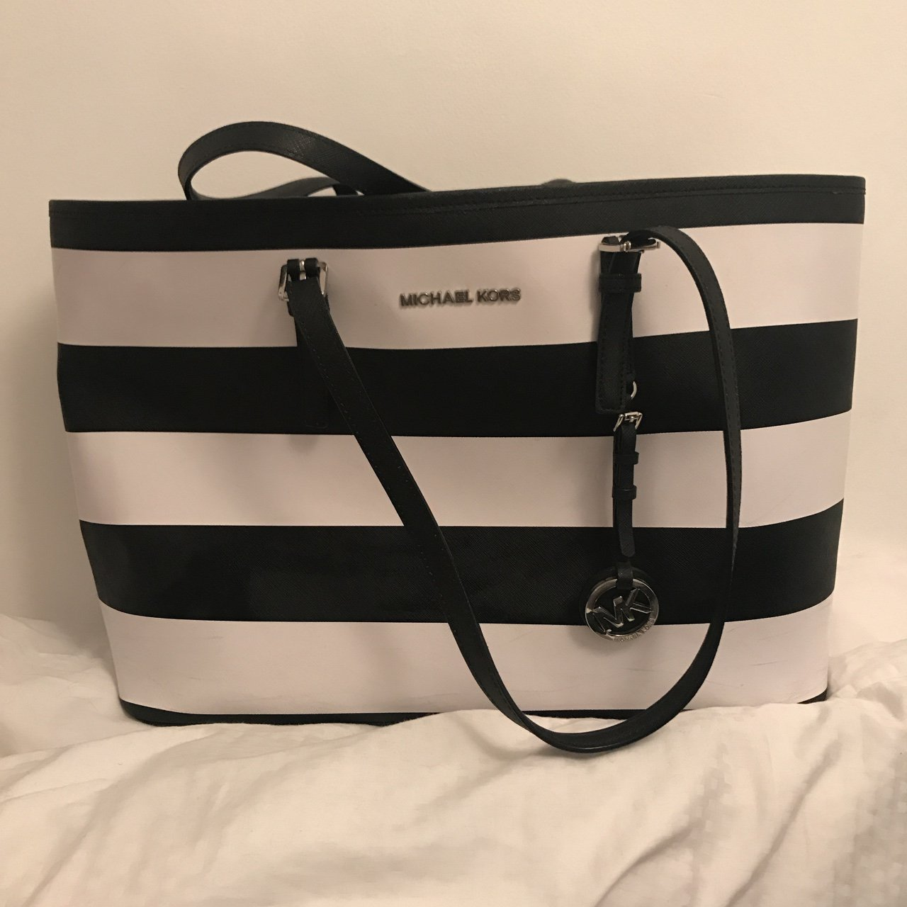 0d248037559177 Michael Kors striped medium travel bag. Black/white. Great a - Depop