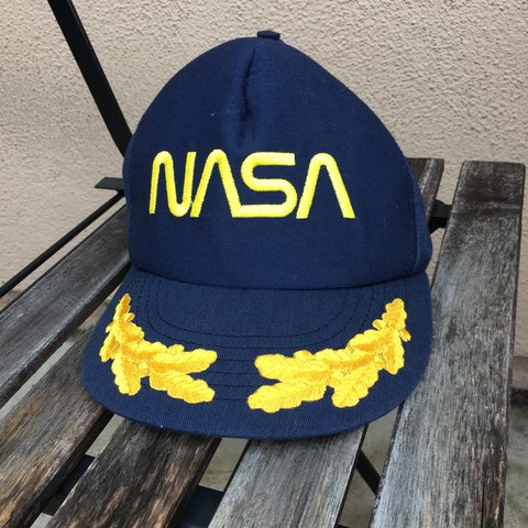a5af7778 @davidsperring. 2 years ago. Huntington Beach, CA, USA. One size fits most vintage  NASA captain hat.