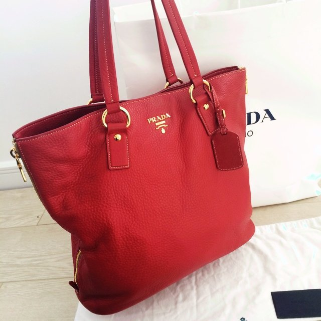 78e1c60750fe @melissalaurenj. 3 years ago. Oxfordshire, United Kingdom. Genuine Prada  Vit Daino bag. Colour: Fuoco. Some small wear ...