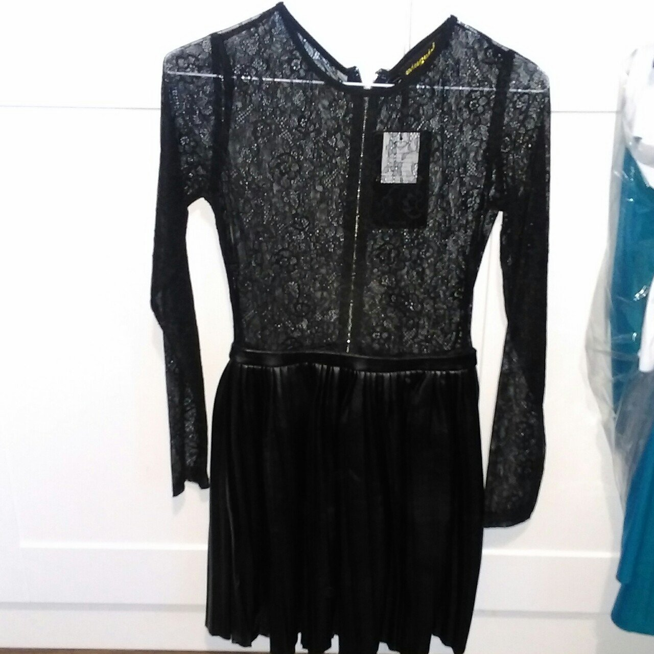 2ad4637119da Black long sleeved lace and leather skater dress