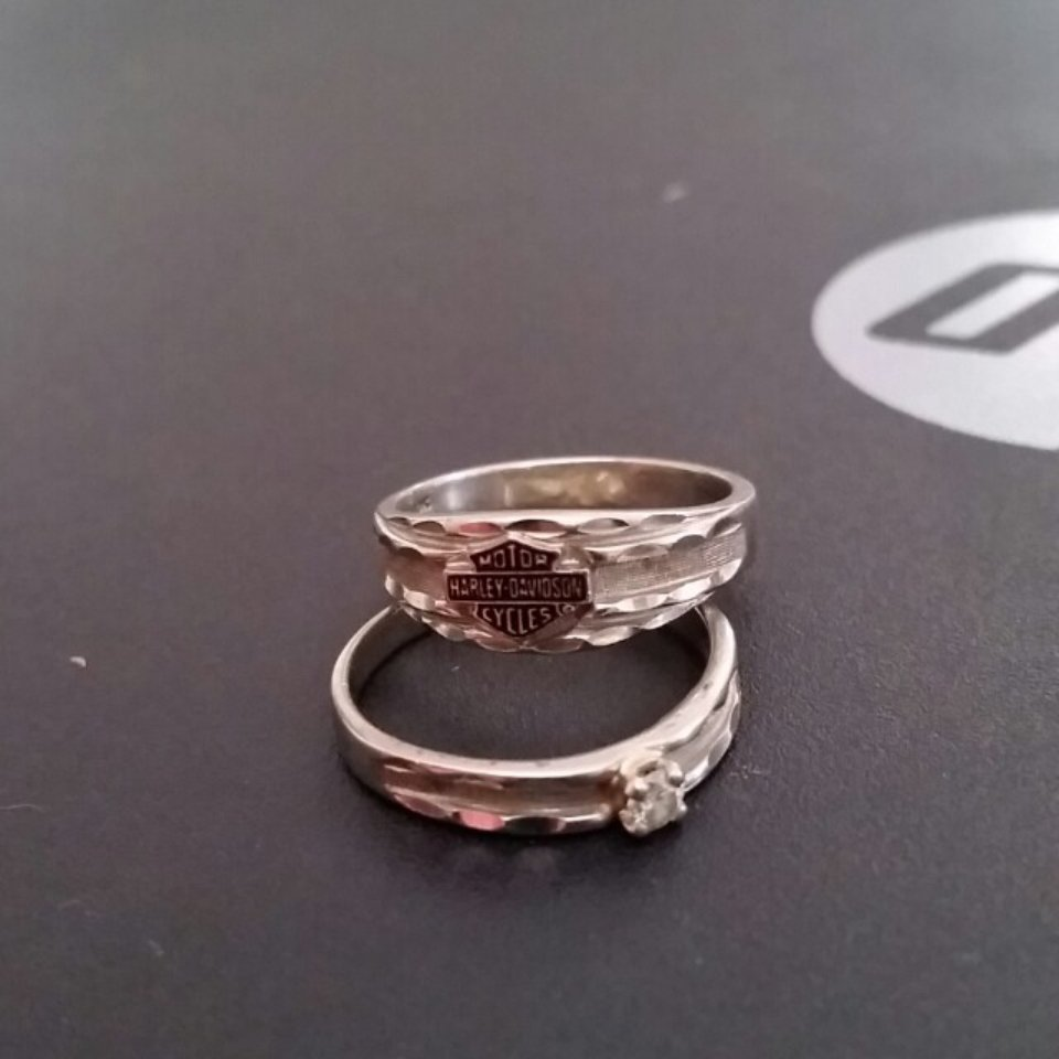 This is a picture of Womens size 39 Harley Davidson wedding ring set. They - Depop
