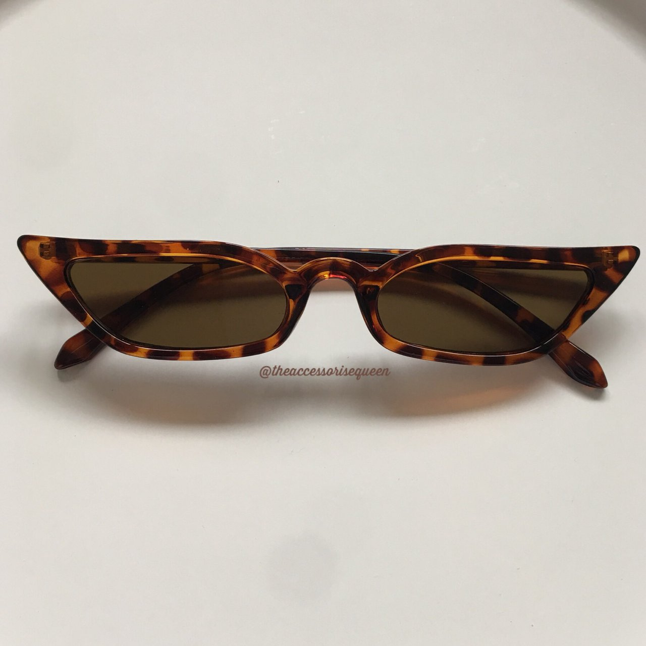 d257309903362 Brown Leopard cat eye winged sunglasses - Depop