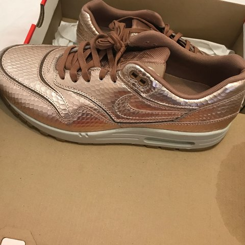 los angeles 797e0 362d1  ssayshi. last year. London, UK. Nike womens air max 1 cut out premium. Bronze  metallic ...