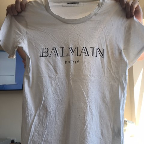 7770ab8e @paigesincs. 29 days ago. Epsom, United Kingdom. MENS white balmain T-shirt.  Size M
