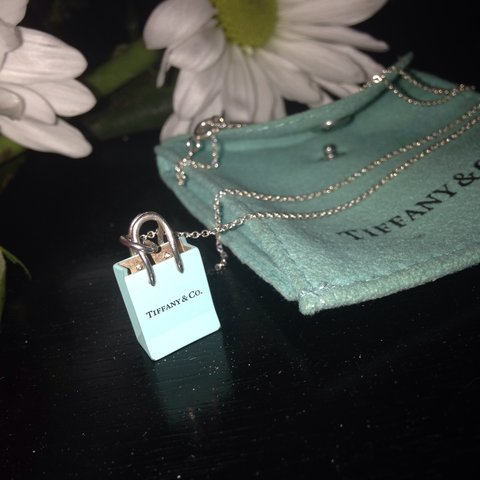 65cc24740 @christylynn17. 3 years ago. Vienna, United States. Tiffany and Co blue shopping  bag charm necklace
